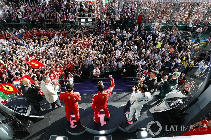 Race winner Sebastian Vettel, Ferrari, second place Lewis Hamilton, Mercedes AMG F1, third place, Ki