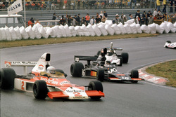 Jochen Mass,McLaren M23 Ford leads Tom Pryce, Shadow DN5A Ford