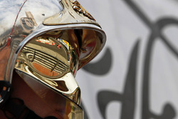 Sebastian Vettel, Ferrari SF70-H reflected in a fire marshals helmet