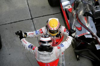 Fernando Alonso, McLaren MP4-22 Mercedes, 1st position, and team mate Lewis Hamilton, McLaren MP4-22 Mercedes. celebrate their McLaren one-two