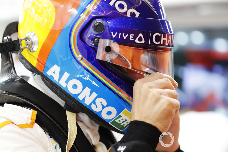 Fernando Alonso, McLaren puts on his helmet in the garag