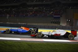 Esteban Ocon, Manor MRT05, leads Esteban Gutierrez, Haas VF-16