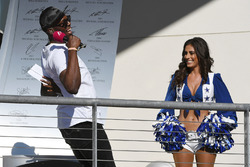 Usain Bolt, grid girl on the podium