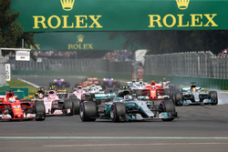 Valtteri Bottas, Mercedes-Benz F1 W08  and Lewis Hamilton, Mercedes-Benz F1 W08  with rear puncture at the start of the race after colliding with Sebastian Vettel, Ferrari SF70H