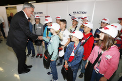 Chase Carey, Chairman, Formula One, meets the grid kids