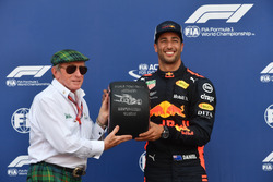 Pole sitter Daniel Ricciardo, Red Bull Racing receives the Pirelli Pole Position Award from Jackie Stewart