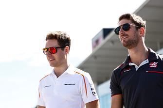 Stoffel Vandoorne, McLaren, with Romain Grosjean, Haas F1 Team