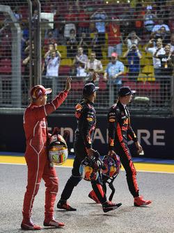 Pole sitter Sebastian Vettel, Ferrari, Daniel Ricciardo, Red Bull Racing and Max Verstappen, Red Bull Racing wave to the crowd in parc ferme