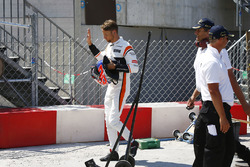 Jenson Button, McLaren, walks back to the pits after retiring from the race
