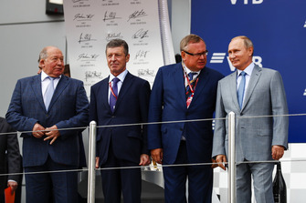 Viktor Kiryanov, Head of State Motor Vehicle Inspectorate of Ministry of Internal Affairs, Dimitry Kozak, Deputy Prime Minister of Russia, Andrey Kostin, President and Chairman of the Management Board of VTB Bank, and Vladimir Putin, President of Russia, on the podium