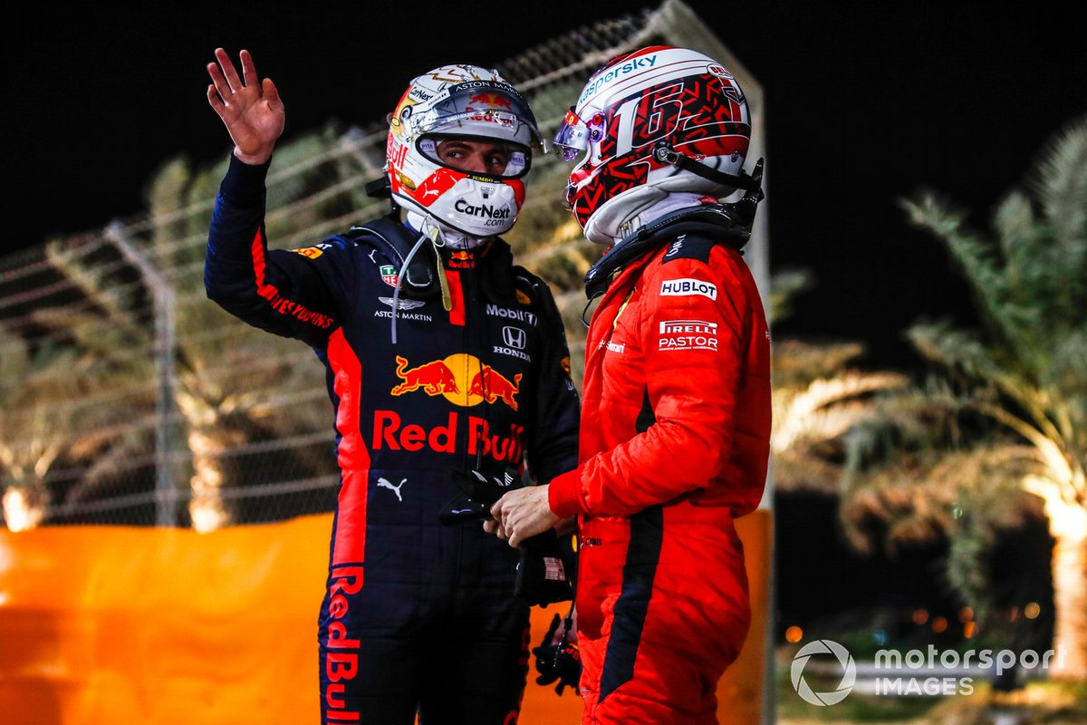 Max Verstappen, Red Bull Racing, and Charles Leclerc, Ferrari, chat after retiring