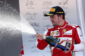 Podium: Fernando Alonso, Ferrari, sprays the Champagne