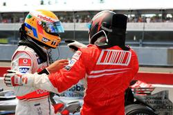 Lewis Hamilton, McLaren; Kimi Räikkönen, Ferrari