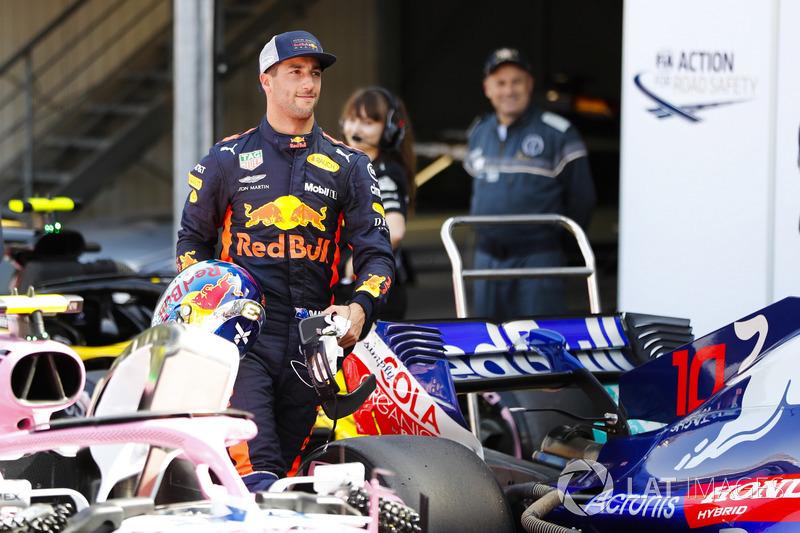 Daniel Ricciardo, Red Bull Racing, walks through parc ferme after setting pole position
