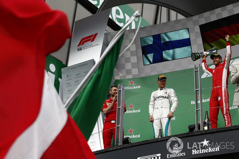 Valtteri Bottas, Mercedes AMG F1, , 2nd position, and Sebastian Vettel, Ferrari, 1st position, on th