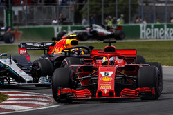 Sebastian Vettel, Ferrari SF71H, leads Valtteri Bottas, Mercedes AMG F1 W09, and Max Verstappen, Red