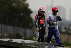 Romain Grosjean, Haas F1 Team heads back to the pits after he crashed on the way to the grid