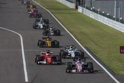 Sergio Perez, Sahara Force India VJM10 and Sebastian Vettel, Ferrari SF70H battle for position