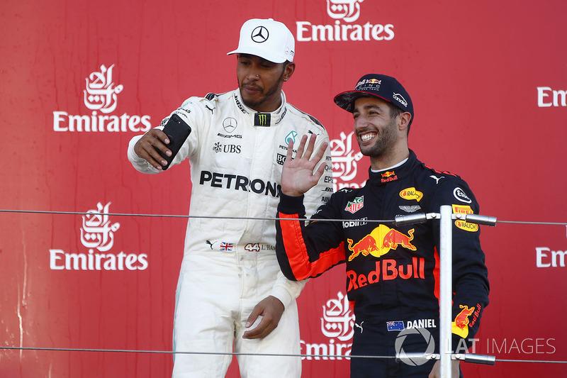 Race winner Third place Lewis Hamilton, Mercedes AMG F1 Daniel Ricciardo, Red Bull Racing, take a photo on the podium
