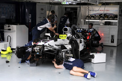 The car of Felipe Massa, Williams FW40 is worked on in the garage by mechanics