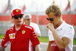 Kimi Raikkonen, Ferrari, with Marcus Ericsson, Sauber