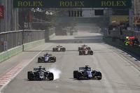 Romain Grosjean, Haas F1 Team VF-17, locks up a wheel as he battles Pascal Wehrlein, Sauber C36-Ferrari