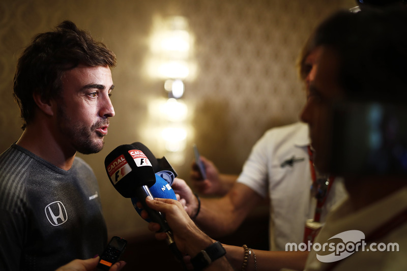 Fernando Alonso talks to the media after announcing his deal to race in the 2017 Indianapolis 500 in an Andretti Autosport run McLaren Honda car