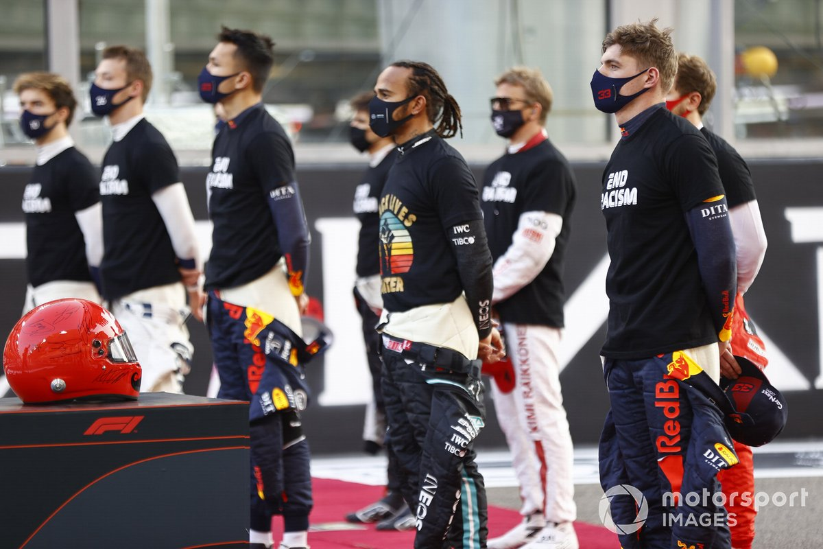 Lewis Hamilton, Mercedes-AMG F1, and the other drivers stand on the grid prior to the start