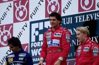 1st: Ayrton Senna McLaren, centre. 2nd: Alain Prost Williams, left. 3rd: Mika Hakkinen McLaren, right.