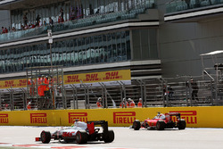 Esteban Gutierrez, Haas F1 Team VF-16 passes Sebastian Vettel, Ferrari SF16-H, who stopped on the st