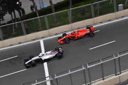 Lance Stroll, Williams FW41 and Kimi Raikkonen, Ferrari SF71H