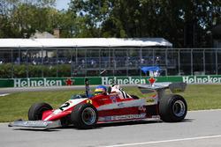 Jacques Villeneuve drives the Ferrari 312T3 driven by his father Gilles Villeneuve on a demonstration lap