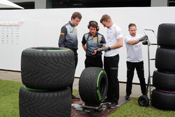 McLaren engineers talk to Pirelli with the wet tyres and the super soft tyres