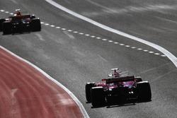 Daniel Ricciardo, Red Bull Racing RB13, Sebastian Vettel, Ferrari SF70H, leave the pits