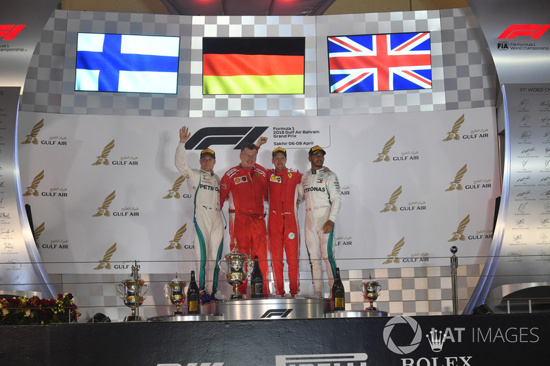 (L to R): Valtteri Bottas, Mercedes-AMG F1, Sebastian Vettel, Ferrari and Lewis Hamilton, Mercedes-AMG F1 celebrate on the podium