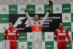 Podium: second place Fernando Alonso, Ferrari, Race winner Jenson Button, McLaren, third place Felip