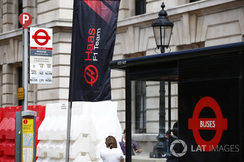A Haas F1 Team banner next to a bus stop in Whitehall