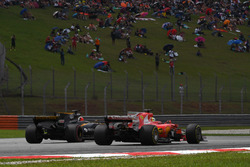 Sebastian Vettel, Ferrari SF70H and Nico Hulkenberg, Renault Sport F1 Team RS17 battle