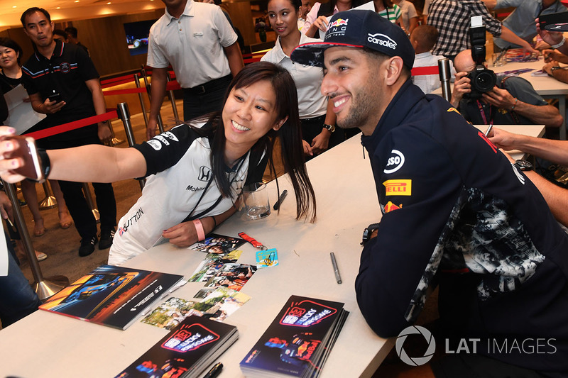 Daniel Ricciardo, Red Bull Racing at the autograph session and poses for a selfie photo