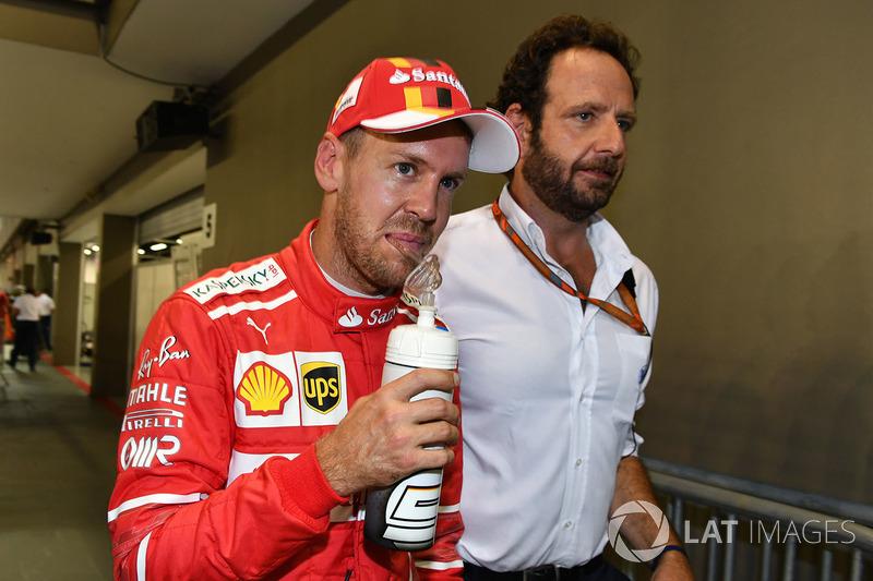Sebastian Vettel, Ferrari and Matteo Bonciani, FIA Media Delegate