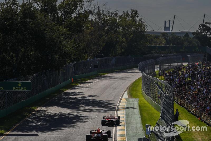 Sebastian Vettel, Ferrari SF70H, leads Max Verstappen, Red Bull Racing RB13