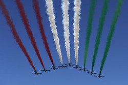 The Italian Ir Force Aerobatics team, Frecce Tricolri, overfly the grid in their Aermacchi MB-339 PAN aircraft