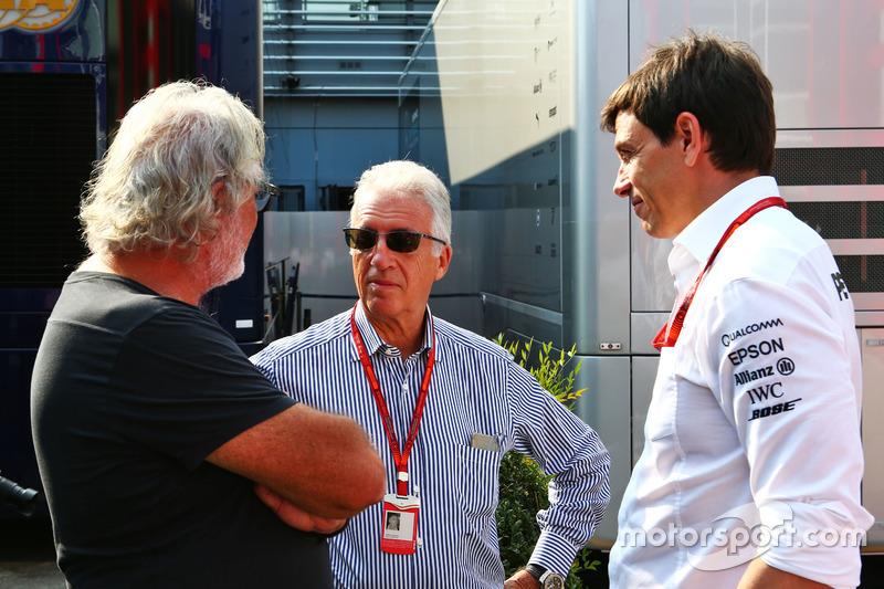 (L to R): Flavio Briatore, with Piero Ferrari, Ferrari Vice-President and Toto Wolff, Mercedes AMG F