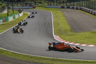 Fernando Alonso, McLaren MCL33 precede Nico Hulkenberg, Renault Sport F1 Team R.S. 18 e Lance Stroll, Williams FW41