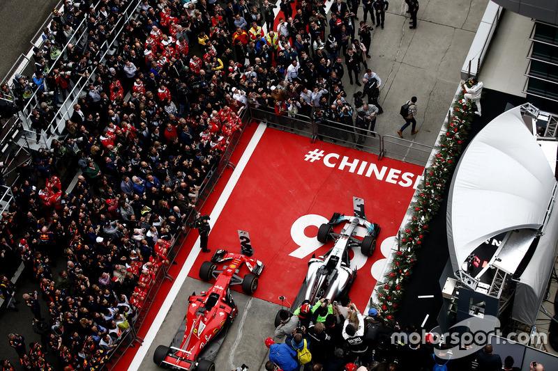 Lewis Hamilton, Mercedes AMG, sprays Champagne on the podium