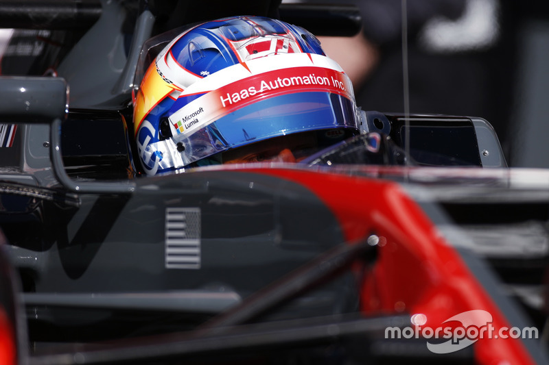 Romain Grosjean, Haas F1 Team, in cockpit with helmet visor raised