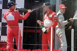Podium: race winner Michael Schumacher, Ferrari, second place Eddie Irvine, Ferrari, third place Mika Hakkinen, McLaren