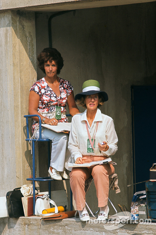 Bette Hill sits on the pit wall checking times for her husband, Graham Hill