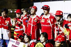 Sebastian Vettel, Ferrari, Kimi Raikkonen, Ferrari, on the stage in the F1 Fanzone