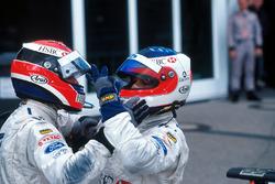 Johnny Herbert and Rubens Barrichello celebrate Stewart Grand Prix victory